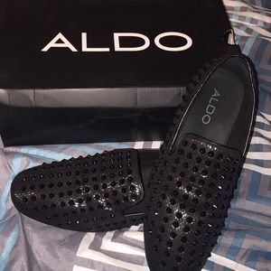 All black spiked Aldo loafers